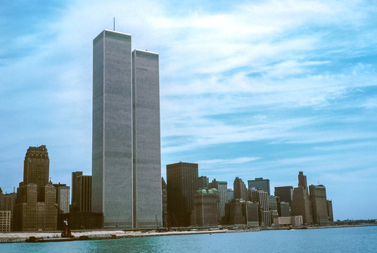 Iconic World Trade Center featured as landmark of the Twin Towers from New Jersey and Hudson River. Archival vintage cityscape of New York city skyline. Manhattan in NYC, United States.