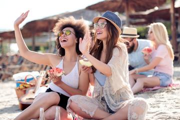 Two woman having fun on the beach