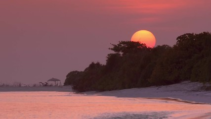 Fototapete - View at sunset on maldivian island. Travel destination