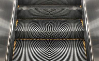 Empty escalator stair machine indoor background.