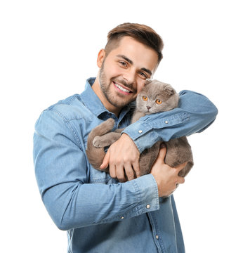 Young man with cute funny cat on white background