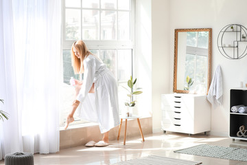 Wall Mural - Morning of young woman applying body cream at home