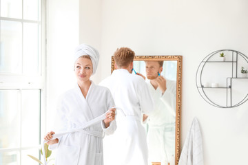 Wall Mural - Morning of happy young couple in bathroom