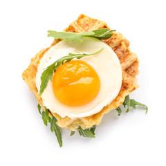 Tasty squash waffles with fried egg on white background
