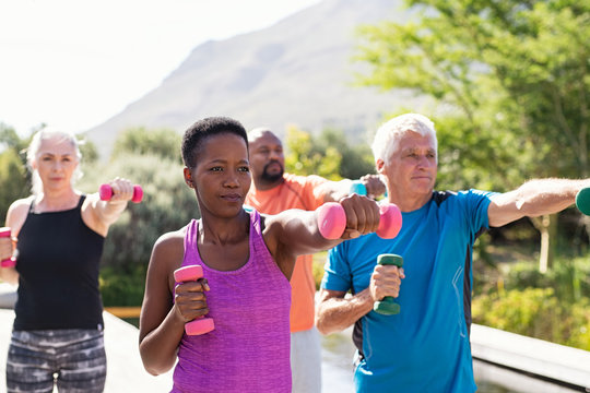 Mature fitness people exercising with dumbbells