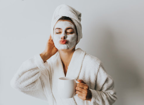 Beautiful Luxury Life. Breakfast. Happy Girl with a Cup of Coffee. Home Style Relaxation Woman Wearing Bathrobe and Towel after Shower. Spa Good Morning.Cosmetic procedure. Beauty spa and cosmetology.