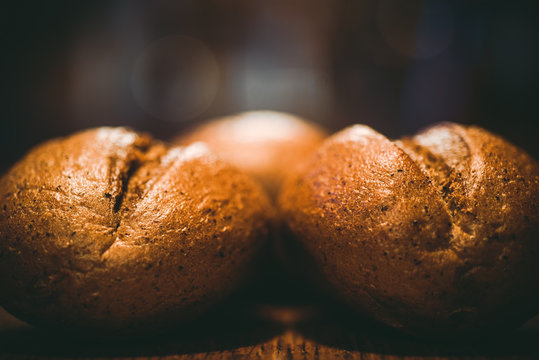 Bread rolls on the table. Dark background
