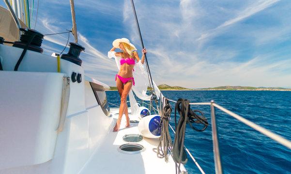 beautiful sexy woman in swimwear relaxing on a yacht