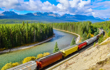 Long freight comtainer train moving along Bow river in Canadian Rockies ,Banff National Park, Canadian Rockies,Canada Fototapete