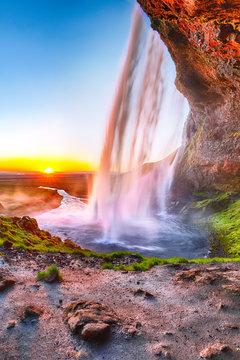 Beautiful  Seljalandsfoss waterfall in Iceland during the sunset