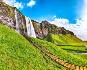 Wall Mural - Fantastic Seljalandsfoss waterfall in Iceland during sunny day.