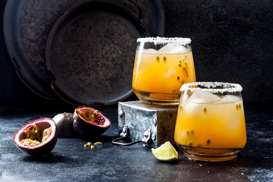 Mango passionfruit margarita cocktail with lime. Tropical alcoholic drink for summer party