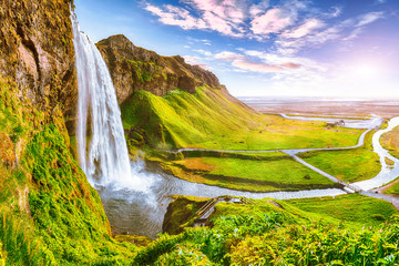 Wall Mural - Beautiful  Seljalandsfoss waterfall in Iceland during the sunset