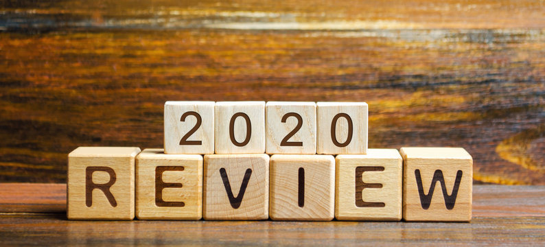 Wooden blocks with the word Review 2020. Business concept. Feedback, Progress. New trends and prospects. Financial performance indicator. Results of the year. Financial and economic activities. Audit.