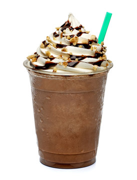 Frappuccino or iced coffee with hazelnut, whipped cream and chocolate syrup in disposable or plastic to go cup isolated on white background
