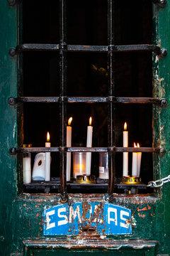 Braga, Portugal. Bom Jesus do Monte. Votive candles on a Station of the Cross aka Calvary and Alms Box aka Esmolas. Baroque. Unesco World Heritage