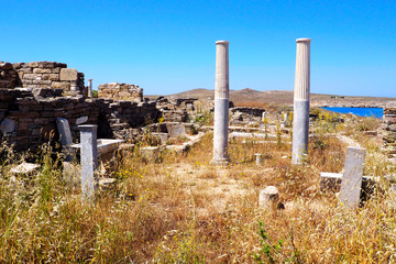 view of the ancients baths in the archaeological city of Delos Island, near Mykonos, beautiful Cycladic island, in the heart of the Aegean Sea