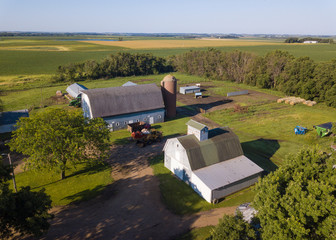 Aerial view of property released farm buildings in South Dakota with fields in the background