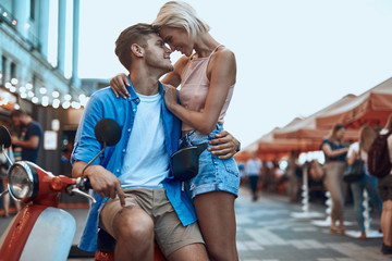Romantic couple head to head hugging at the fair