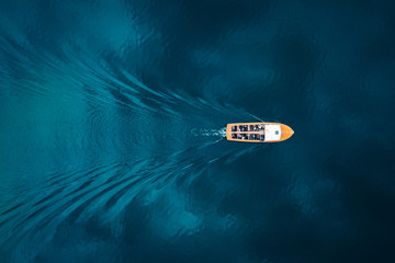 Overhead view of boat on blue water