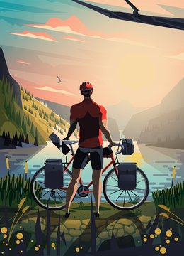 Cyclist in the mountains staring at the lake