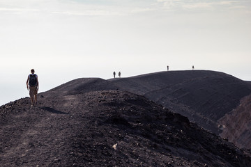 Aeolian Islands, Vulcano, Panoramic view from volcano, hikers at volcanic crater