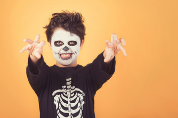 Happy Halloween. funny child in a skeleton costume of halloween