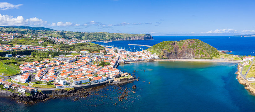 Fort de San Sebastian, idyllic praia (beach) and azure turquoise baia (bay) do Porto Pim, red roofs of historical touristic Horta town centre, Monte (mount) Queimado, Faial island, Azores, Portugal.