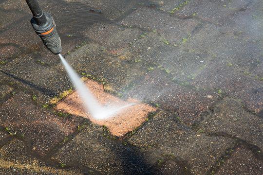 sidewalk concrete block floor clean with high pressure water jet