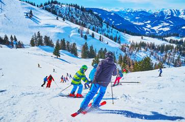 The skiers on snow run, Zwieselalm mountain, Gosau, Austria Wall mural
