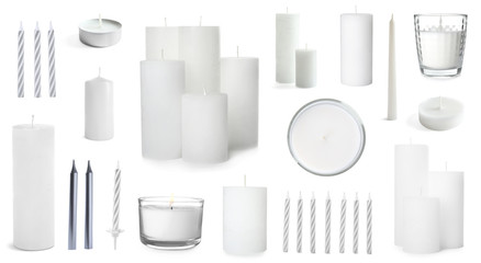 Five color wax candles on white background