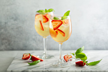 Summer white sangria with strawberries and basil