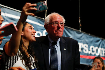 Democratic 2020 U.S. presidential candidate and U.S. Senator Sanders looks away after taking picture with a supporter following a town hall event in Los Angeles