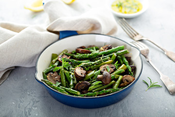 Asparagus and mushrooms sauteed in a cast iron pan with lemon zest