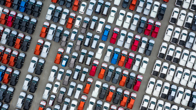 Aerial view new cars export terminal, New cars waiting for import export at deep sea port.