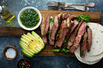Aluminium Prints Steakhouse Mexican steak with avocado, tortillas and green sauce