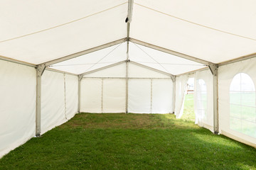 Inside empty white tent waiting for event arrangement Wall mural