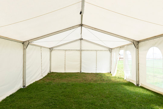 Inside empty white tent waiting for event arrangement