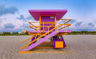 Multicolored and vibrant coast lifeguard beach tower house at walking distance from Art Deco District in Ocean Drive, Miami, Florida. Gay friendly colors of a modern beach house in a sunny day