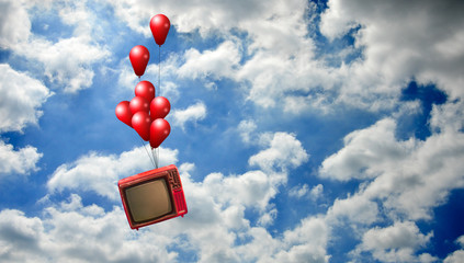 Flying television with red balloons in sky, Freedom of broadcasting concept