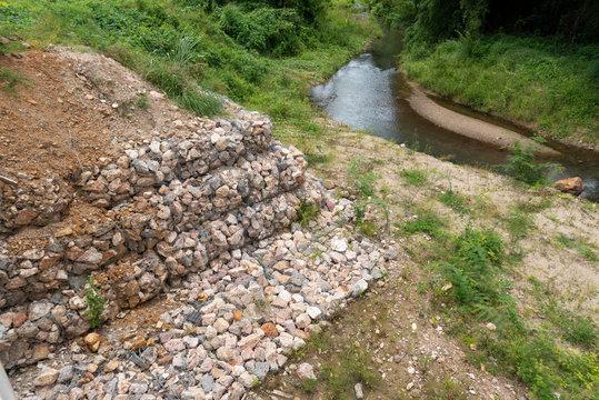 Stacks of rock in wire for prevent landslide