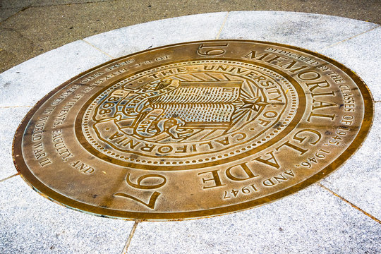 The seal of the University of California, Berkeley on the campus on the ground