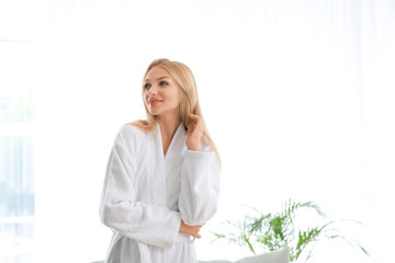 Wall Mural - Morning of young woman in bathrobe at home
