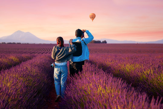 Asian couple travel in lavender field