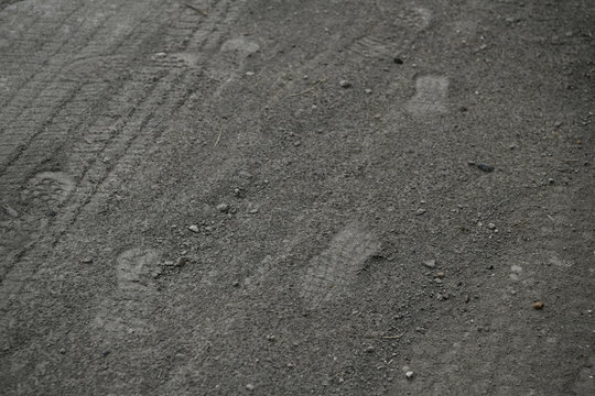 Fresh shoe prints are seen at a migrant crossing spot on the Rio Grande near Mission