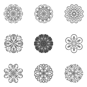 Flower vector set in sketch style. Isolated black icons on white background.