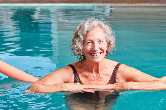 Smiling senior makes aqua fitness