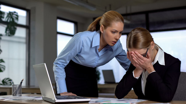 Boss shouting at frustrated employee, bullying and emotional abuse at work