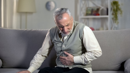 Old male having strong abdominal ache, stomach ulcer disease, health problems
