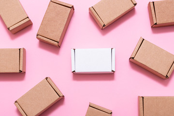 Lot of small cardboard boxes on pink background Wall mural
